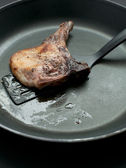 Frying meat piece on frying pan — Stock Photo