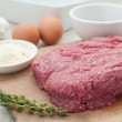 Royalty-Free Stock Photo: Raw ground meat with eggs and components for cooking