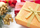 Gift box with christmas present ans decor — Stock Photo