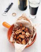Crackling pork skin beer snack — Stock Photo