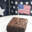 Brownie and american flag — Stock Photo