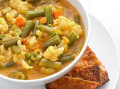 Curry soup with vegetables — Stock Photo