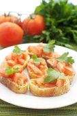 Crostini with tomatoes — Stock Photo