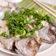Healthy cooked whole fish with scallions and cilantro — Stock Photo