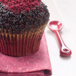 Chocolate muffins with red sugar decoration — Stock Photo
