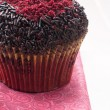 Red velvet muffin with chocolate sprinkles — Stock Photo #22496987