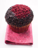 Muffin decorated with red sugar — Stock Photo