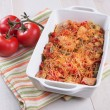 Cheese bakes vegetables and poultry casserole - Stock Photo