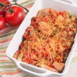 Chicken, string beans and tomatoes cheese casserole - Stock Photo