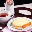 Lemon pound cake with tea on a tray — Stock Photo