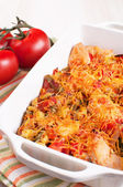 Tomatoes, chicken and cheese casserole — Stock Photo