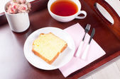 Tray with breakfast tea and lemon loaf — Stock Photo