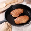 Stock Photo: Frying pwith cooking duck breast