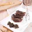 Slices of cooked duck breast with herbs sauce — Stock Photo