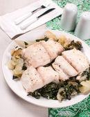 Flounder fillet on bok choy cabbage — Stock Photo