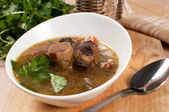 Hearty soup with bone-in ox tail — Stock Photo