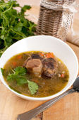 Bowl of ox tail meat soup with barley — Stock Photo
