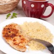 Breaded chicken cutlets with couscous - Stock Photo