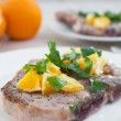 Meat steak with oranges and cilantro — Stock Photo