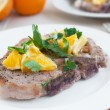 Pork bone-in chops with oranges and herbs — Stock Photo
