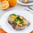 Fried pork meat with citrus salsa — Stock Photo