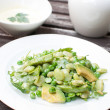 Green salad with peas, limbeans and arugula — Stock Photo #26592429
