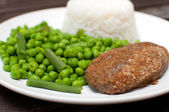 Chicken kiev or cordon bleu dinner — Stock Photo