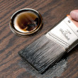 Painting wood in brown with brush — Stock Photo