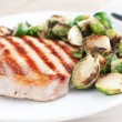 Pork chop with brussels sprouts — Stock Photo