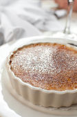 Creme brulee in white ramekin — Stock Photo