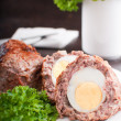 Eggs coated with ground meat roasted — Stock Photo