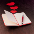 Writing about love in notebook — Stok fotoğraf