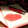 Red notepad for love message — Stok fotoğraf