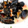 Plate of mussels in garlic sauce — Stock Photo