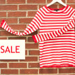 Red and white striped shirt with sale sign — Stock Photo #28007603