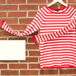 Red and white striped shirt with sign  — Stock Photo