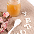 Jar with honey and spoon — Stock Photo #28302551