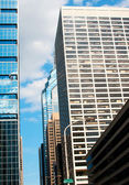 City street with skyscrapers and sky — Stock Photo