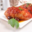 Chicken thighs sauteed with tomato and olives — Stock Photo #28503939