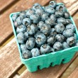 Carton box with fresh ripe blueberry  — Stock Photo