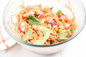Salad with carrots, radishes and chicken — Stock Photo