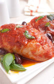 Chicken thighs with tomato sauce — Stock Photo