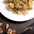 Cooked pasta with walnut sauce — Stock Photo