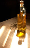 Golden olive oil in sun light — Stock Photo