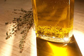 Flavoring olive oil with herbs — Stock Photo