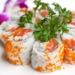 Closeup california salmon sushi rolls — Stock Photo #29696253