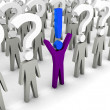 One man with exclamation mark and a lot of men with question mar — Stock Photo