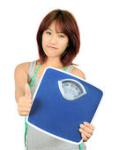 Isolated young slim asian woman on white — Stock Photo