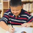 Young asian boy happy with his homework — Stock Photo