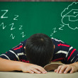 Stockfoto: Asiboy's sleeping on book and dreaming of graduation